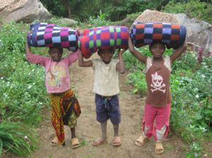 Helping to carry blankets