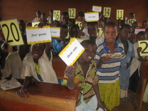 Kwembalazi_pupils_with_teaching_aids[1]